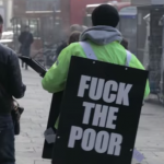 "Watch People React to This Guy Wearing a ""F*ck The Poor"" Sign"