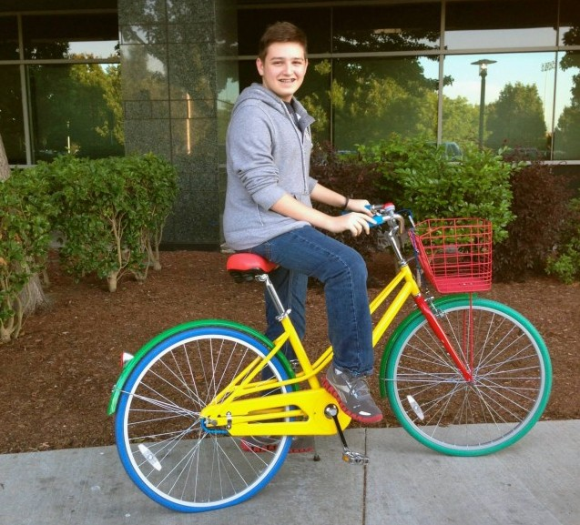 Michael riding a Google bike at Googles HQ.