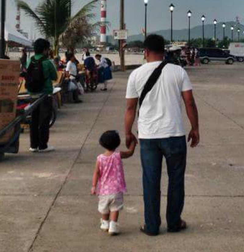 Filipina Mom Secretly Takes Pictures of Husband and Daughter Holding