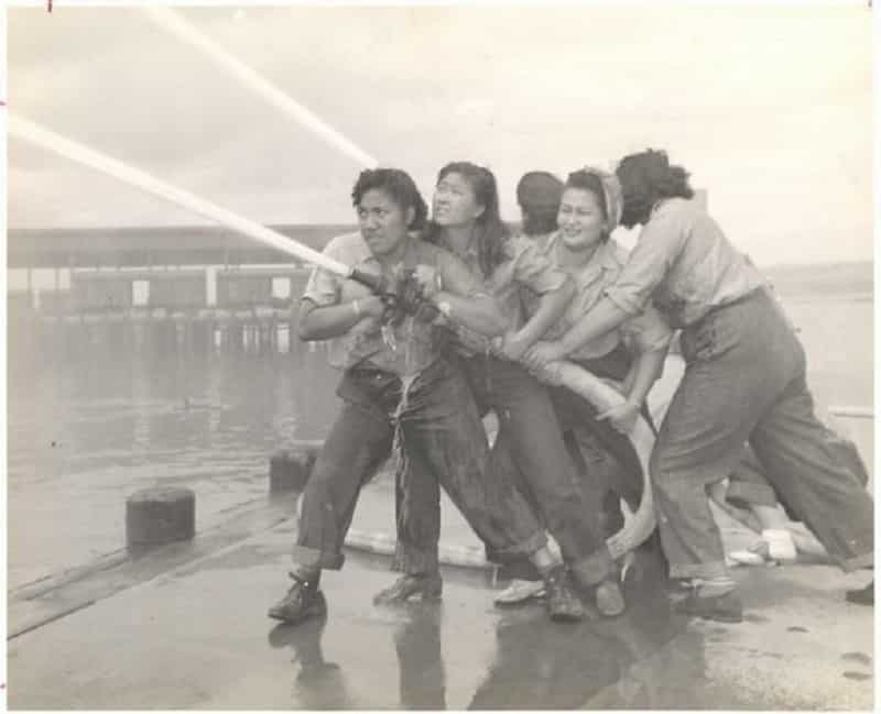 A photograph of four young women purportedly hosing a fire during the Japanese attack on Pearl Harbor has appeared on several mainstream publications and history books as an iconic symbol of determination against adversity.