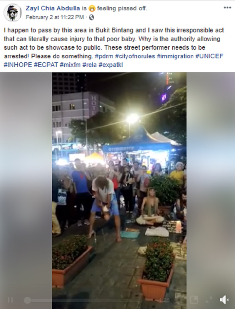 """A revolting video recently emerged on social media featuring a group ofbegpackers(travelers who ask for handouts to fund their travels)using a real baby as a prop during a bizarre """"street performance"""" in Kuala Lumpur, Malaysia."""