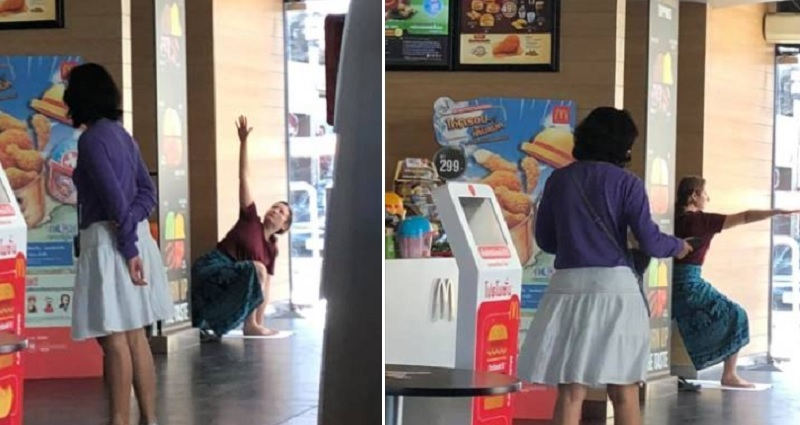 Foreign Woman Does Impromptu Yoga Session Inside A -1468
