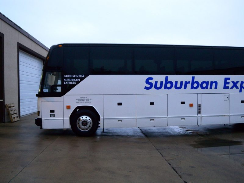 Suburban Express has coughed up a six-figure payment in a legal battle that stemmed from an email advertisement in which they mocked Chinese students.