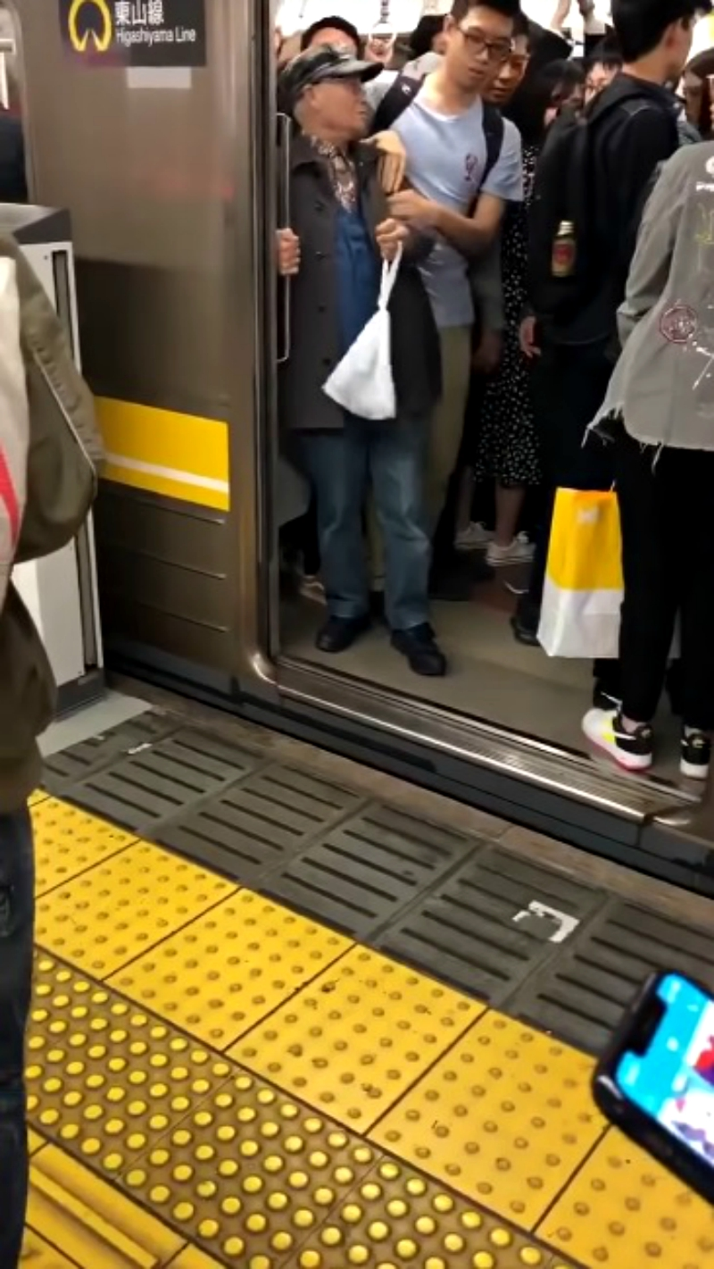 An elderly Japanese commuter who managed to stop a train has gone viral on social media.