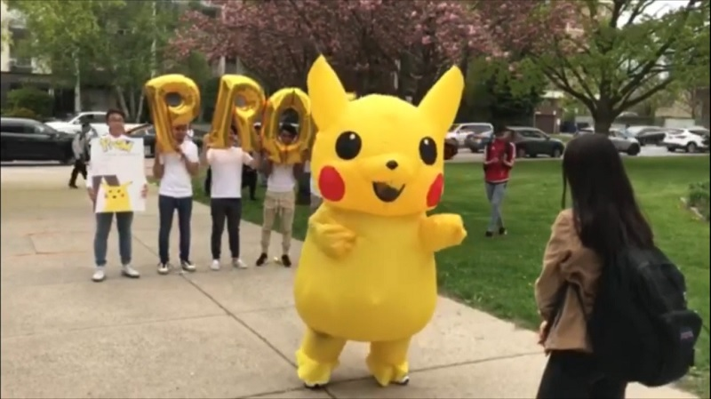 Sometimes simply going up to someone and asking them out to prom isn't extravagantenough which is why this student chose to ask a girl out in public while wearing a massive Pikachu costume.