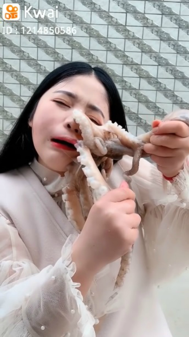 A Chinese livestreamer found her face writhing in pain as an octopus tried to defend itself in her attempts to eat it alive.