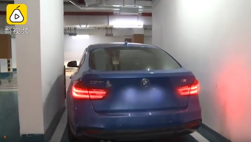 """A Chinese woman is taking an apartment developer to court after finding out that the """"premium"""" parking space she purchased won't let her exit her car unless she passes through the sunroof."""