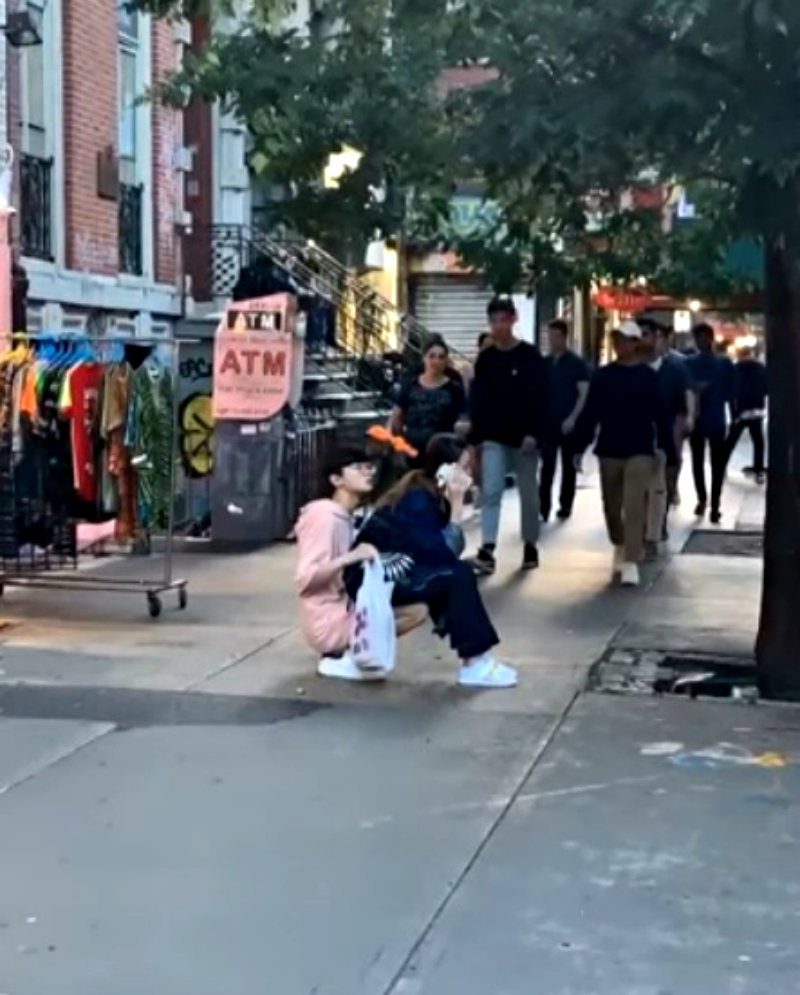 A man who turned himself into a chair for his girlfriend to sit on in public has gone viral on social media.