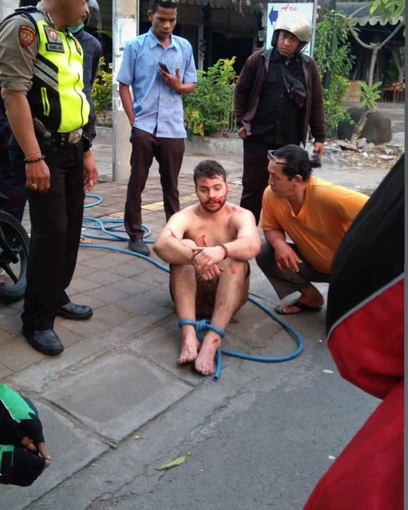 An Australian tourist was arrested in Bali, Indonesia after committing a slew of random, violent acts on the streets over the weekend.