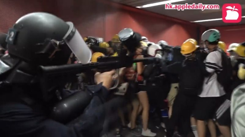 A police officer shot pepper balls point-blank at a group of protesters in Hong Kong over the weekend.