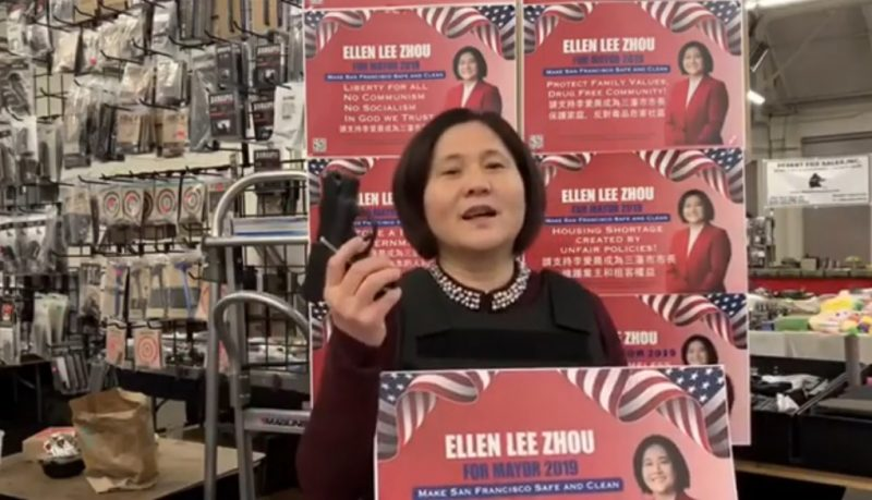 """Ellen Lee Zhou, whose supporters have branded as the """"Chinese Donald Trump,"""" sponsored the billboard showing a Black woman in a red dress and heels with her feet up, holding a cigarette in one hand and a stack of cash in the other."""