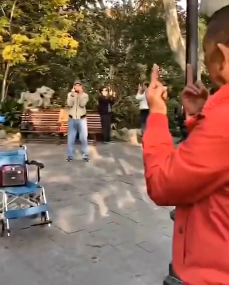 A video of a group of elderly people raising their middle fingers during a meditation session at a park in Shanghai has gone viral on social media.