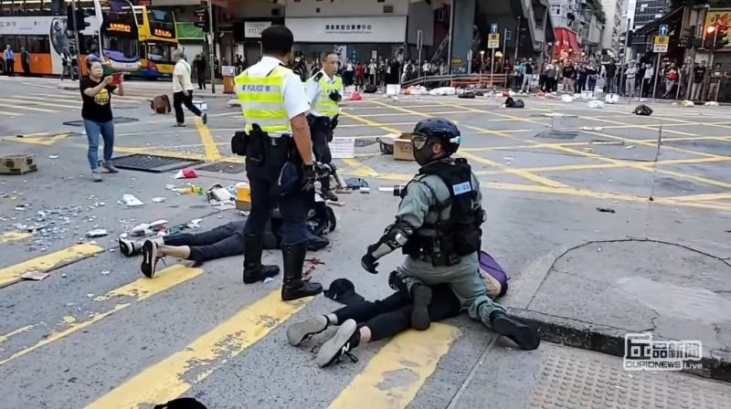 Two protesters have been shot by Hong Kong police during a confrontation in a general strike on Monday.