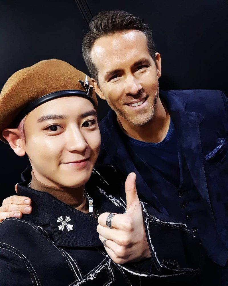 Ryan Reynolds has rubbed elbows with K-Pop group EXO this week.